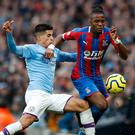 Crystal Palace's Wilfried Zaha, right, saw his late strike deflected in to claim a draw against Manchester City (Martin Rickett/PA)