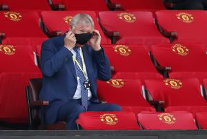 Former Manchester United manager Sir Alex Ferguson fiddles with his face mask during West Ham's visit to Old Trafford. The protective equipment became compulsory for the select few fortunate enough to attend post-lockdown matches, including 78-year-old Ferguson (Clive Brunskill/PA)