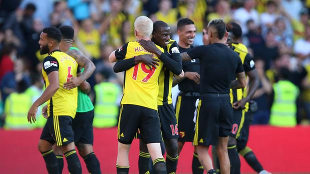 Watford's Will Hughes (centre left) and Abdoulaye Doucoure celebrate after the Premier League match at Vicarage Road, Watford.