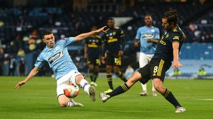 Manchester City's Phil Foden (left) and Arsenal's Dani Ceballos battle for the ball during the Premier League match at the Etihad Stadium (Peter Powell/NMC Pool)