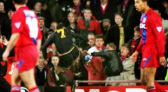 Infamous moment: Eric Cantona launches into the Palace crowd