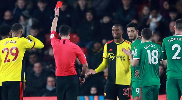 Christian Kabasele (centre) was sent off for Watford (Adam Davy/PA)
