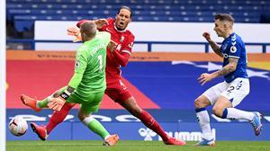 Liverpool defender Virgil Van Dijk will see a consultant on Sunday with the club concerned about a knee injury sustained in the Merseyside derby (Laurence Griffiths/PA)