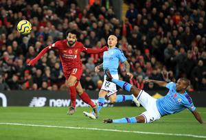 Liverpool hold a 20-point lead over nearest rivals Manchester City (Peter Byrne/PA)