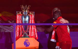 Happy days: Sadio Mane grins with delight as he gets up close with the Premier League trophy