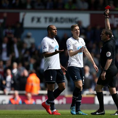 Tottenham Hotspur's Younes Kaboul (left) with team mate Michael Dawson appeals to Referee Phil Dowd after being shown a red card