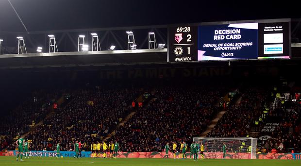 Christian Kabasele was sent off after input from VAR (Adam Davy/PA)