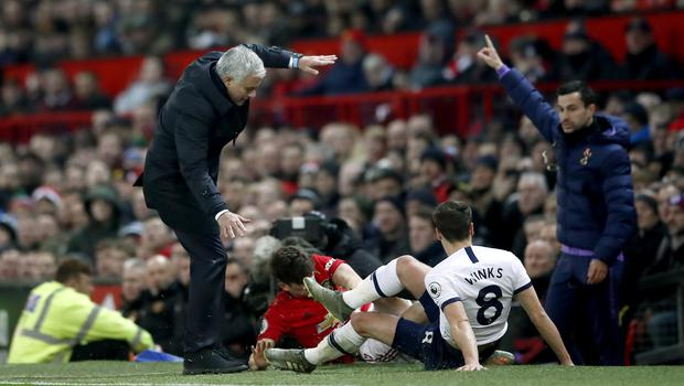 Mourinho was almost knocked off his feet in the first half (Martin Rickett/PA)