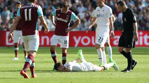 Jack Cork will miss Swansea's clash with Watford after spraining his ankle against West Ham last weekend