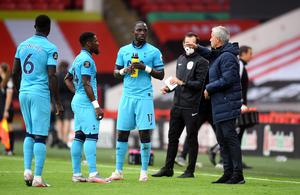Mourinho speaks to Serge Aurier and Moussa Sissoko during a break in play (Michael Regan/NMC Pool/PA)
