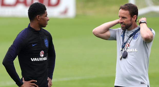 Could England manager Gareth Southgate (right) look to deploy Marcus Rashford down the middle? (Nick Potts/PA)