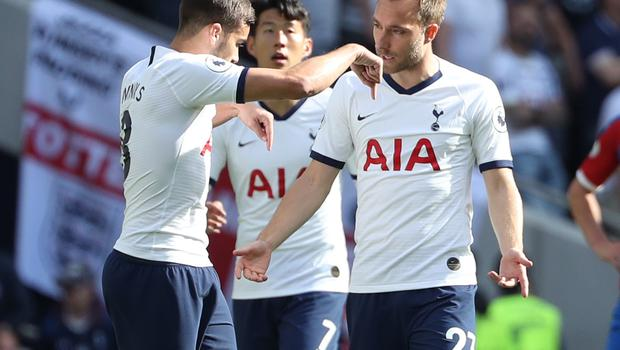 Christian Eriksen (right) was expected to leave Spurs in the summer transfer window (Yui Mok/PA).
