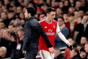 Ozil was left out of Arteta's Premier League and Europa League squads this season (John Walton/PA)