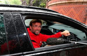Driving seat: Jurgen Klopp arrives back at his home yesterday