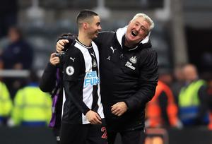 Newcastle manager Steve Bruce, right, shares a joke with Miguel Almiron after the player ended his Premier League drought against Crystal Palace in December. Paraguay international Almiron, a £21million signing from MLS club Atlanta United, had gone 26 top-flight games without a goal before sparking wild celebrations at St James' Park by earning a 1-0 win over the Eagles (Owen Humphreys/PA)