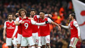 Arsenal's Alexandre Lacazette, centre, celebrates with team-mates after scoring what proved to be the only goal against West Ham (Bradley Collyer/PA)