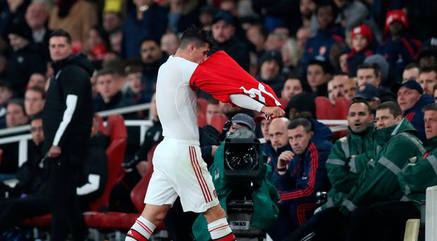 Falling out: Granit Xhaka storms off the pitch at the Emirates after being heckled by Arsenal fans