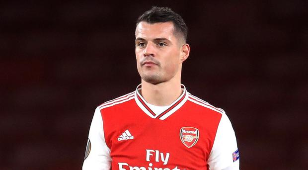 Arsenal's Granit Xhaka has been heavily linked with a move to Hertha Berlin (Adam Davy/PA).