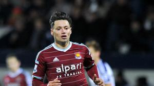 Harry Redknapp admits QPR are in talks over a loan deal for West Ham striker Mauro Zarate, pictured