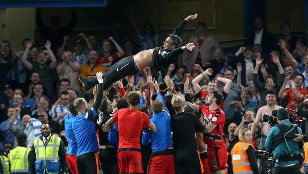 David Wagner celebrates Huddersfield's Premier League survival with his players