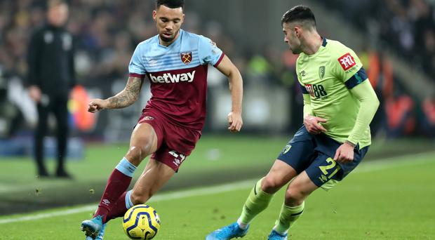 Ryan Fredericks, left, helped West Ham get back to winning ways (Bradley Collyer/PA)