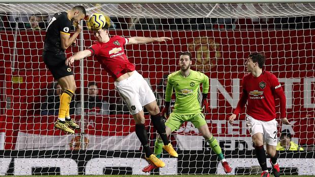 Romain Saiss, left, felt he could have done more with his chances at Old Trafford (Martin Rickett/PA)