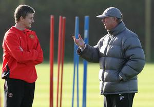 Ole Gunner Solskjaer, left, is appreciative of Sir Alex Ferguson's guidance (Martin Rickett/PA)