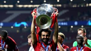 Liverpool's Mohamed Salah holds aloft the European Cup after the Reds beat Tottenham in the 2019 Champions League final (Martin Rickett/PA)