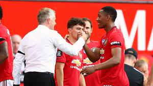 Manchester United manager Ole Gunnar Solskjaer shakes hands with Anthony Martial after he is substituted (Michael Steele/NMC Pool/PA)