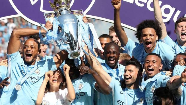 City players celebrate their title win