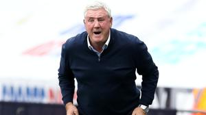 Newcastle manager Steve Bruce says it would be wrong to settle for mid-table respectability.