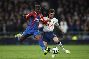 Wilfried Zaha, left, and Ben Davies battle for the ball (Nick Potts/PA)