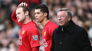Wayne Rooney (left) played alongside Cristiano Ronaldo as part of Sir Alex Ferguson's all-conquering Manchester United side (Nick Potts/PA)