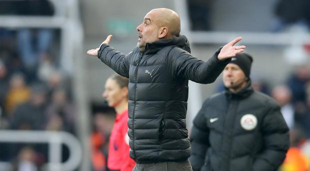 Manchester City manager Pep Guardiola showed his frustration during the 2-2 draw at Newcastle (Owen Humphreys/PA)