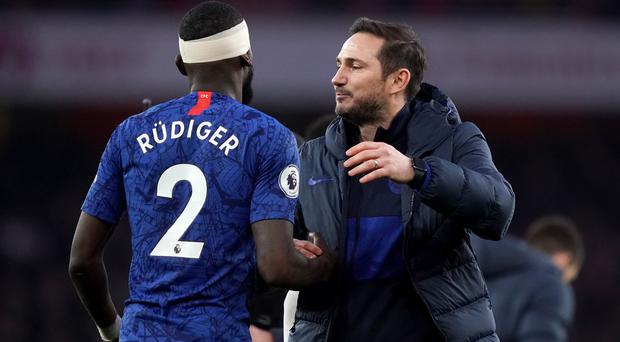 Chelsea's Antonio Rudiger shakes hands with manager Frank Lampard (John Walton/PA)