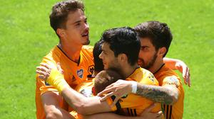 Raul Jimenez (centre) celebrates with team-mates after scoring a penalty to set Wolves on their way to a 3-0 win over Everton.