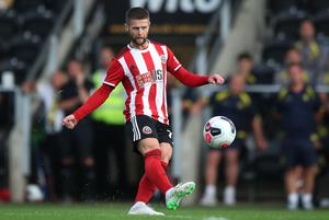 Oliver Norwood pulls the strings in midfield for the Blades (Nick Potts/PA)