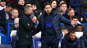 Frank Lampard, right, questions fourth official Kevin Friend during a VAR check (John Walton/PA)