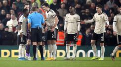 Manchester United have been fined for surrounding referee Craig Pawson (Martin Rickett/PA)