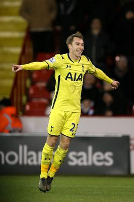 Sting in the tail: Christian Eriksen celebrates after scoring the decisive second goal against Sheffield United