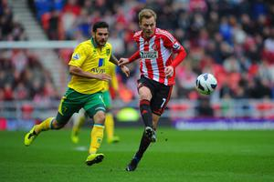 SUNDERLAND, ENGLAND - MARCH 17: Bradley Johnson of Norwich in action with Sebastian Larsson of Sunderland during the Barclays Premier League match between Sunderland and Norwich City at the Stadium of Light on March 17, 2013 in Sunderland, England.  (Photo by Michael Regan/Getty Images)