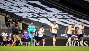 Hugo Lloris, centre left, and Son Heung-min, centre right, come out at the start of the second half (Adam Davy/NMC Pool/PA)