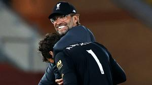 Liverpool manager Jurgen Klopp celebrates victory with goalkeeper Alisson after the Premier League match against Crystal Palace (Phil Noble/NMC Pool)