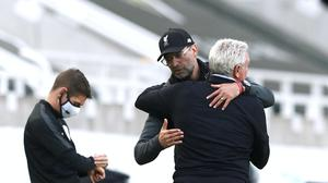 Liverpool manager Jurgen Klopp and Newcastle head coach Steve Bruce embrace after the final whistle ( Jan Kruger/PA)