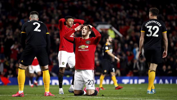 Diogo Dalot reacts to his late miss against Wolves (Martin Rickett/PA)