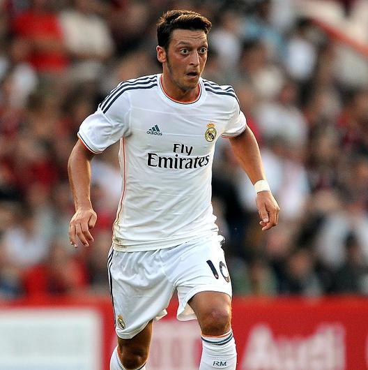 Joachim Low believes Mesut Ozil, pictured, will fit in well at Arsenal