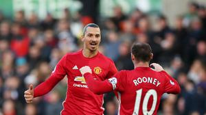 Zlatan Ibrahimovic (left) scored twice before being booked in Manchester United's 3-1 win at Swansea.