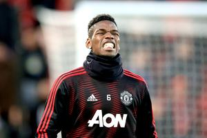 Manchester United's Paul Pogba was left on the bench at Liverpool (Peter Byrne/PA)