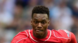 Liverpool striker Daniel Sturridge is to remain in the United States over Christmas to continue his rehabilitation from a thigh injury