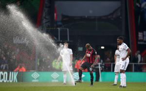 Jordon Ibe takes matters into this own hands after Bournemouth's home defeat to Wolves is briefly interrupted by a sprinkler malfunction. Winger Ibe left the Vitality Stadium before the end of the prolonged season having managed just five Premier League goals following a £16million move from Liverpool in 2016 (John Walton/PA)